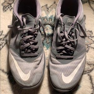 Silver Nike running shoes